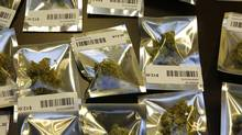 Medical marijuana is packaged for sale in one-gram packages at the Northwest Patient Resource Center medical marijuana dispensary on Nov. 7, 2012, in Seattle. (Ted S. Warren/AP)