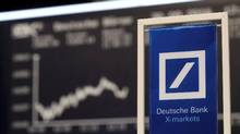 A banners of Deutsche Bank is pictured in front of the German share price index, DAX board, at the stock exchange in Frankfurt, Germany, September 30, 2016. (KAI PFAFFENBACH/REUTERS)