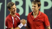 Canada's Vasek Pospisil, left, and doubles partner Daniel Nestor celebrate after defeating Ecuador in a Davis Cup doubles match in Guayaquil, Ecuador, Saturday July 9, 2011. (AP Photo/Patricio Realpe) (Patricio Realpe/AP)