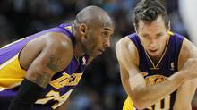 Los Angeles Lakers guards Kobe Bryant, left, and Steve Nash confer during a break in action in the fourth quarter of the Denver Nuggets' 126-114 victory over the Lakers in an NBA game in Denver on Wednesday, Dec. 26, 2012. (David Zalubowski/AP)