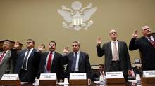 """Witnesses are sworn in at a hearing held by the House Oversight and Government Reform Committee on """"Operation Fast and Furious: The Other Side of the Border,"""" on Capitol Hill in Washington in this file photo taken July 26, 2011. The U.S. Justice Department's internal watchdog on Wednesday issued a 471-page report following a 19-month review by the department's inspector general into """"Operation Fast and Furious,"""" which allowed about 2,000 potentially illegal firearms to cross the border into Mexico. (KEVIN LAMARQUE/REUTERS)"""