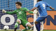 Canada goalkeeper Michael Misiewicz (18) blocks a shot by Isidro Gutierrez (9), of El Salvador, in the first half of a CONCACAF Olympic qualifying soccer match on Thursday, March 22, 2012, in Nashville, Tenn. (Mark Humphrey/AP)