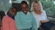 Canadian activist Fiona Sampson, with The Equality Effect, a Toronto-based organization, travels with two girls in Meru, Kenya. (The Equality Effect)