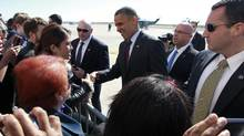 U.S. President Barack Obama greets well-wishers as he arrives at New York's JFK Airport, October 16, 2012, en route to the second presidential debate against Mitt Romney. (JASON REED/REUTERS)
