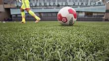 A group of female soccer players has mounted a legal challenge against the use of artificial turf in the 2015 World Cup. (JASON FRANSON/THE CANADIAN PRESS)
