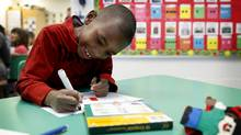 In three months of full-day kindergarten, Mekhi Rutherford, 5, has gone from sounding out words to reading anything he wants. (Anne-Marie Jackson/The Globe and Mail)