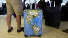 Passengers checking one bag on WestJet's international flights will pay a $25 fee that matches the levy the airline places on bags checked on domestic flights. (Peter Power/The Globe and Mail)