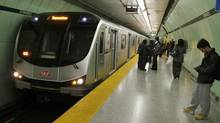 A new subway train is shown in Toronto in December, 2012. The parent company of Gateway Newsstands, which operates kiosks in TTC stations, has threatened legal action if the company's contract extension is revoked. (Fernando Morales/The Globe and Mail)