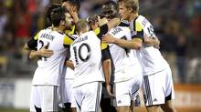 Jul 19, 2014; Columbus, OH, USA; Columbus midfielder Bernardo Anor (7) is congratulated by teammates following his second goal in the teams win 2-1 versus the Montreal Impact at Crew Stadium. (Joseph Maiorana/USA Today Sports)