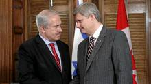 Canada's Prime Minister Stephen Harper shakes hands with Israel's Prime Minister Benjamin Netanyahu during a meeting in Harper's office on Parliament Hill in Ottawa May 31, 2010. (CHRIS WATTIE/CHRIS WATTIE/REUTERS)