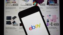 The eBay Inc. logo and application are displayed on a an Apple Inc. iPhone 5s and iPad in this arranged photograph in Washington, D.C., U.S., on Friday, April 25, 2014. (Andrew Harrer/Bloomberg)