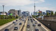 Cars drive in traffic on the Gardiner Expressway in Toronto, June 29, 2015. The Ontario government's climate change plan will see more than $7-billion spent over four years. (MARK BLINCH/REUTERS)