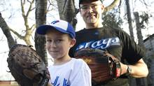 Toronto Blue Jays fans Matt Visentin and his son Thomas are looking forward to the upcoming baseball season. (Kevin Van Paassen/The Globe and Mail)
