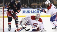 Carey Price of the Montreal Canadiens stops a shot by J.T. Miller of the New York Rangers as Jordie Benn of the Canadiens helps defend in the second period AT Madison Square Garden on March 4, 2017 in New York. (Paul Bereswill/Getty Images)