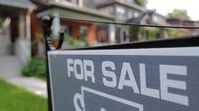 A sign advertises a house for sale on a residential street in midtown Toronto on July 12, 2017. (CHRIS HELGREN/REUTERS)