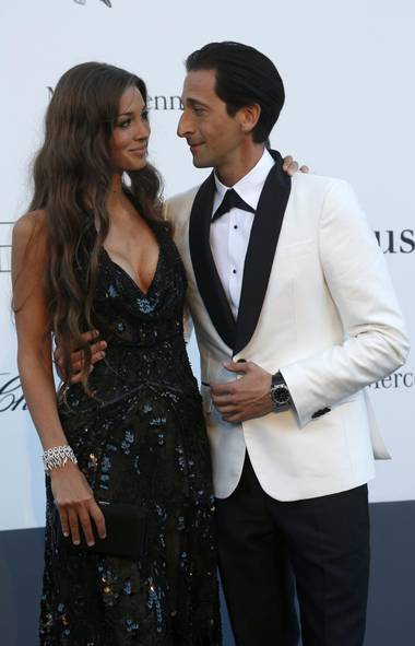 Model Lara Lieto and actor Adrien Brody arrive at amfAR's Cinema Against AIDS event in Antibes during the Cannes Film Festival on Thursday evening. (Jean-Paul Pelissier/Reuters)