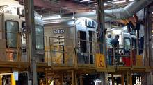 A file photo of Bombardier employees working on a rail car at the La Pocatière, Que. plant. (Benoit Gariepy/CP)