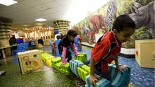 Children play at the newly renovated Cedarbrae Public Library in Scarborough on Nov. 16, 2011. (Michelle Siu/Michelle Siu for The Globe and Mail)
