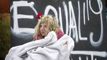 An Occupy Toronto protester in Toronto, (Kevin Van Paassen/The Globe and Mail)