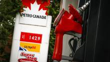 A pump is seen at a Petro-Canada gas station in Toronto on June 23, 2014. In a recent study, the IMF is arguing that countries should raise fuel tax by more than 50% to encourage people to go green. (MARK BLINCH/REUTERS)