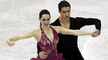 Tessa Virtue and Scott Moir of Canada perform during the ice dance short dance at the ISU World Figure Skating Championships in Nice March 28, 2012. (Reuters)