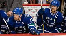 Vancouver Canucks' Daniel Sedin, left, and his twin brother Henrik Sedin sit on the bench late in the third period of their 4-1 loss to the Montreal Canadiens in Vanvouver, Saturday. (Darryl Dyck/The Canadian Press/Darryl Dyck/The Canadian Press)