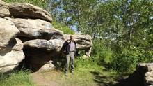 Archeologist Jonathan Driver, at the Tse'K'wa cave he helped discover, says a concerted effort is needed to save Peace River valley's history. (Barbara Winter)