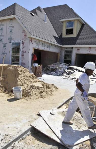CONSTRUCTION: Workers finish up a house in Wylie, Texas. U.S. builders began work in June on the most new homes in nearly four years. Housing starts rose 6.9 per cent from May in June to a seasonally adjusted annual rate of 760,000. That's the highest since October 2008. The level of construction remains well below the rate of roughly 1.5 million homes a year that's considered healthy and the two million rate reached during the housing bubble. But it's much stronger than the annual rate of 478,000 homes at the depth of the housing bust. (LM Otero/AP)