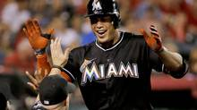 FILE - In this Aug. 25, 2014, file photo, Miami Marlins' Giancarlo Stanton celebrates his home run against the Los Angeles Angels during the fourth inning of a baseball game in Anaheim, Calif. (Chris Carlson/AP)
