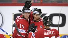 Corey Perry, goal scorer Evander Kane and Kyle Quincey celebrate