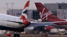 """Nigeria's Civil Aviation Authority said it was fining British Airways $135-million and Virgin Atlantic $100-million for what it called """"abuse of a dominant position, fixing prices, abusing fuel surcharges and taking advantage of passengers."""" (Max Nash/AFP/Getty Images/Max Nash/AFP/Getty Images)"""