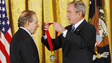 In this Nov. 15, 2007 file photo, President George W. Bush, right, presents the 2007 National Humanities Medal to Roger Hertog during a ceremony in the East Room of the White House in Washington. Hertog posted the $2 million bond for Conrad Black on Wednesday July 21, 2010. (Gerald Herbert/The Associated Press)