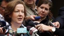 Alberta Premier Alison Redford, left, scrums with the media following her meeting with B.C. Premier Christy Clark in Calgary on Oct. 1, 2012. (Jeff McIntosh/THE CANADIAN PRESS)