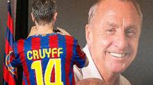 A football fan wearing a jersey of FC Barcelona pays tribute to late Dutch football star Johan Cruyff in a special condolence area set up at Camp Nou stadium in Barcelona on March 26, 2016. (PAU BARRENA/AFP/Getty Images)