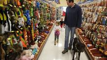 A family shops for new pet toys during at a PetSmart in Dallas in 2013. The pet supply/services store's EPS have declined just once in the past 10 years. (Richard W. Rodriguez/Associated Press)