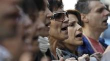 Protesters shout slogans during an anti-austerity rally in Athens February 24, 2012. (YIORGOS KARAHALIS)