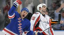 New York Rangers center Olli Jokinen reacts in front of Washington Capitals right wing Boyd Gordon (15) after he scored a goal in the first period of their NHL hockey game at Madison Square Garden in New York, February 4, 2010. REUTERS/Ray Stubblebine (RAY STUBBLEBINE)