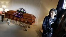 "Family members grieve with Tina Fontaine's casket on the Sagkeeng First Nation. Her death, retired judge Ted Hughes says, could mark a turning point because ""public attention has been seized … A roundtable is the beginning of what might be the long-term solution."" (Lyle Stafford For the Globe and Mail)"