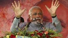 Indian prime ministerial candidate Narendra Modi addresses supporters during a campaign rally at Balasore on Friday, April 11, 2014. (Biswaranjan Rout/Associated Press)