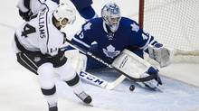 Toronto Maple Leafs' Jonathan Bernier makes a late save during the third period of an NHL game at the ACC in Toronto on Dec. 11, 2013. (Peter Power/The Globe and Mail)