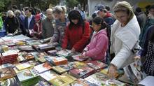 People browse at the Word on the Street outdoor book fair held at Queens Park Circle in Toronto, Sept. 23, 2012. (J.P. MOCZULSKI for The Globe and Mail)
