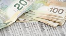 Canadian Money on stock market (Brad Wynnyk/Getty Images/Hemera)
