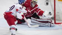 Canada's goalie Mike Smith makes a save against Czech Republic Tomas Hertl during first period preliminary round action Sunday, May 12, 2013 at the world hockey championship in Stockholm Sweden (Jacques Boissinot/THE CANADIAN PRESS)