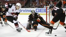 In this Sept. 27, 2016, file photo, Anaheim Ducks' Cam Fowler, right, moves the puck away from Arizona Coyotes' Dylan Strome, left, in front of Ducks goalie Matthew Hackett during the first period of an NHL preseason hockey game, in Anaheim, Calif. Strome and many other young players are awaiting a decision from their clubs on whether to keep them for the full season or send them back to junior hockey. (Jae C. Hong/AP)