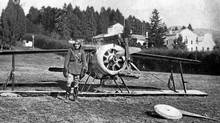 "Major William. G. Barker poses with the wreckage of Sopwith F1 ""Camel"" aircraft of No. 28 Squadron, RAF, in 1918 in Italy. (National Archives of Canada/The Canadian Press/National Archives of Canada/The Canadian Press)"