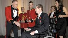 General Walt Natynczyk, left, greets Captain Trevor Greene. (Fred Lum/Fred Lum/The Globe and Mail)