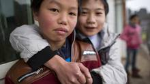 Two boys outside a school in Guizhou, January 15, 2013. (John Lehmann/The Globe and Mail)