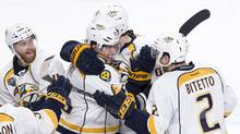 Nashville Predators' Craig Smith (15) celebrates his game-winning goal against the Montreal Canadiens with his teammates following NHL hockey shootout action, in Montreal on Monday, Feb. 22, 2016. (Paul Chiasson/THE CANADIAN PRESS)