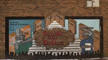 A mural near 605 Whiteside Place in Toronto's Regent Park on Jan. 24, 2013. A 15-year-old youth Tyson Bailey suffering from multiple gunshot wounds at the housing complex died in hospital Friday. (Moe Doiron/The Globe and Mail)