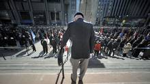 Robert Connery, an 87-year-old navy veteran who served in the Second World War, stands outside Toronto's Old City Hall during Remembrance Day ceremonies on Nov 11 2010. (Fred Lum/Fred Lum/The Globe and Mail)